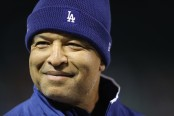 Los Angeles Dodgers manager Dave Roberts looks on during batting practice before Game 2 of the World Series against the Boston Red Sox