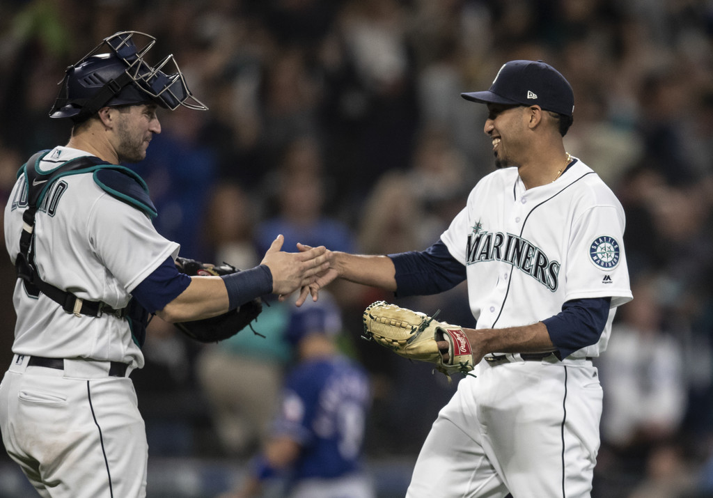 Former Seattle Mariners catcher Mike Zunino celebrates with Edwin Diaz after a game against the Texas Rangers