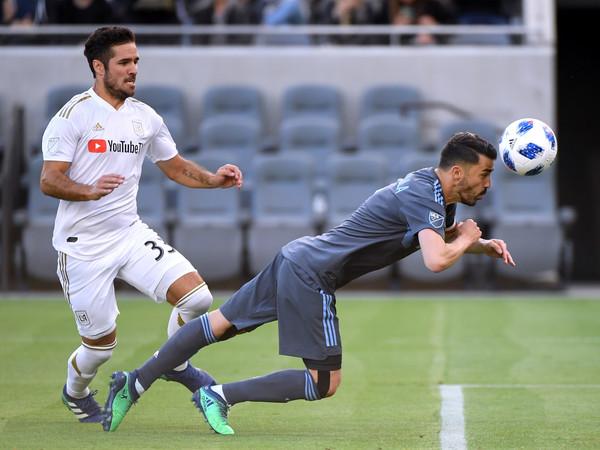 NYFC striker David Villa heads In a rebound against Los Angeles FC