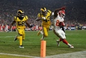 Kansas City Chiefs running back Kareem Hunt is stopped on a run play by Los Angeles Rams' Cory Littleton