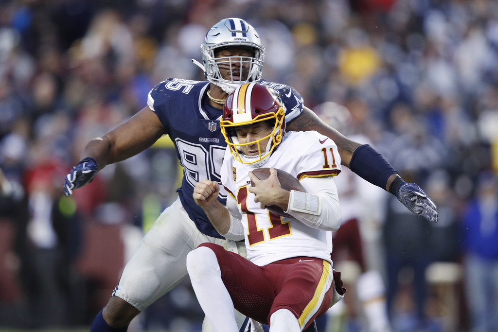 Washington Redskins quarterback Alex Smith being sacked by Dallas Cowboys' David Irving