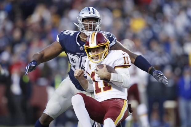 Washington Redskins quarterback Alex Smith being sacked by Dallas Cowboys' David Irving