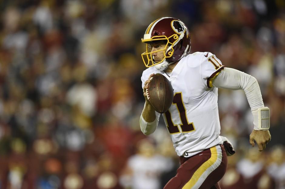 Washington Redskins quarterback Alex Smith scrambles with the ball against the Dallas Cowboys