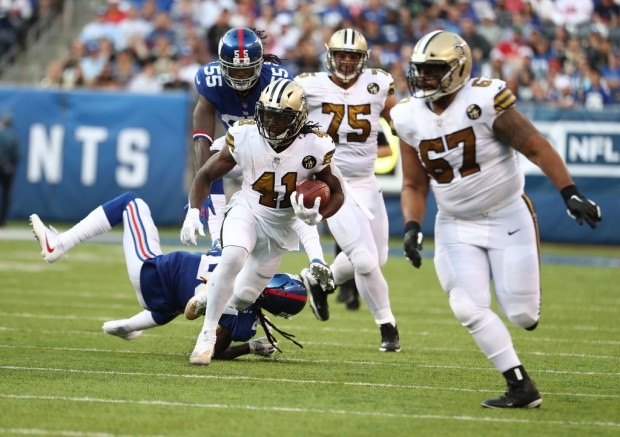 New Orleans Saints running back Alvin Kamara running the ball against the New York Giants