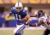 Former Indianapolis Colts wide receiver Anthony Gonzalez runs with the ball against the Houston Texans