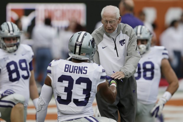 Kansas State Wildcats head coach Bill Snyder greets Tyler Burns during warmups prior to the Texas Longhorns game