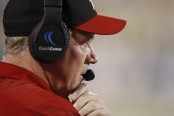 Former Louisville Cardinals head coach Bobby Petrino looking on against the Georgia Tech Yellow Jackets