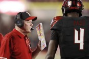 Former Louisville Cardinals head coach Bobby Petrino talking to Jawon Pass against the Georgia Tech Yellow Jackets