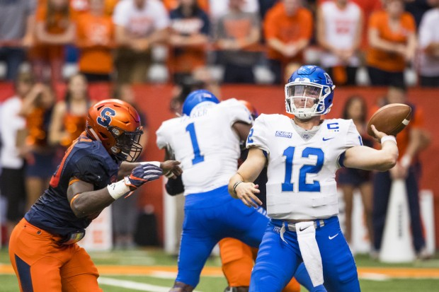 Middle Tennessee State Blue Raiders quarterback  Brent Stockstill attempting a pass against the Syracuse Orange