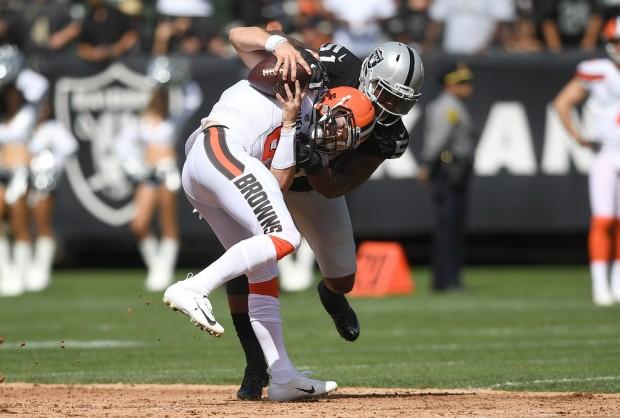 Oakland Raiders outside linebacker/defensive end Bruce Irvin tackling Cleveland Browns quarterback Baker Mayfield