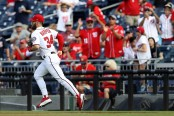 Former Washington Nationals outfielder Bryce Harper takes the field against the Miami Marlins