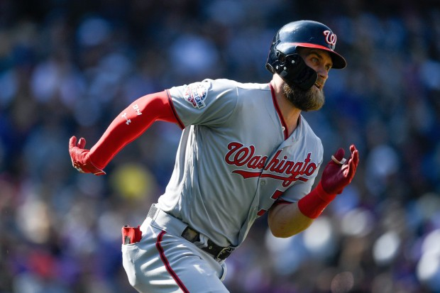 Washington Nationals star Bryce Harper runs out a double against the Colorado Rockies