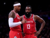 Disgruntled Houston Rockets player Carmelo Anthony talking to James Harden during a game