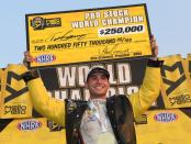 Gray Motorsports driver Tanner Gray holds up his championship check