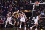 Then-Phoenix Suns Center Tyson Chandler defends Atlanta Hawks' Miles Plumlee