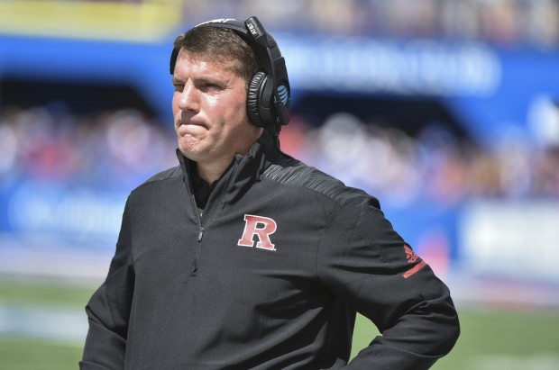 Rutgers Scarlet Knights head coach Chris Ash watches his team against the Kansas Jayhawks