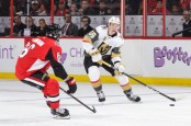 Ottawa Senators defenseman Chris Wideman has the puck passed by him by Vegas Golden Knights' Erik Haula