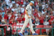 Former Kansas City Royals pitcher Chris Young reacts after giving up a three-run home run against the Los Angeles Angels