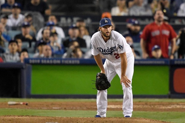 Los Angeles Dodgers pitcher Clayton Kershaw reacts after giving a home run to Mookie Betts in the World Series