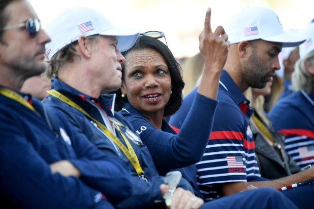 Former Secretary of the State Condoleezza Rice talks with actor and TV personality Greg Kinnear at the opening ceremony of the 2018 Ryder Cup