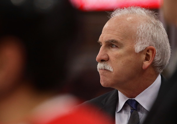Former Chicago Blackhawks head coach Joel Quenneville watches his team against the Los Angeles Kings