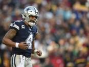 Dallas Cowboys quarterback Dak Prescott reacts after a play against the Washington Redskins