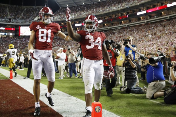 Alabama Crimson Tide running back Damien Harris reacts after scoring a touchdown against the Missouri Tigers