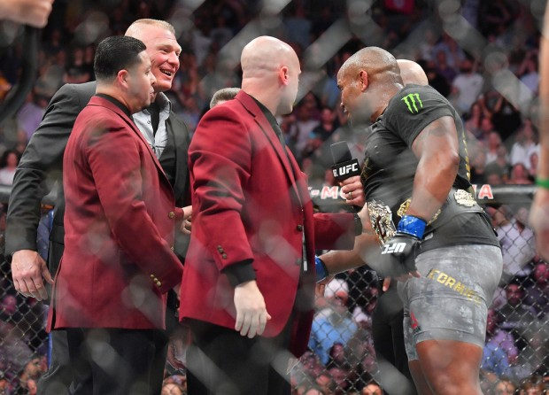 UFC champion Daniel Cormier talking to Brock Lesnar as they are separated by security
