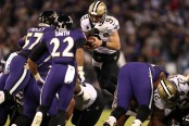 New Orleans Saints quarterback Drew Brees dives with the ball to convert a fourth down against the Baltimore Ravens