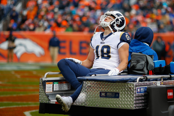 Los Angeles Rams wide receiver Cooper Kupp being carted off the field with a knee injury against the Denver Broncos in October