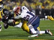Disgruntled Pittsburgh Steelers running back Le'Veon Bell diving with the ball against the New England Patriots