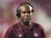 Former Texas State head coach Everett Withers looks on from the sidelines against the Arkansas Razorbacks