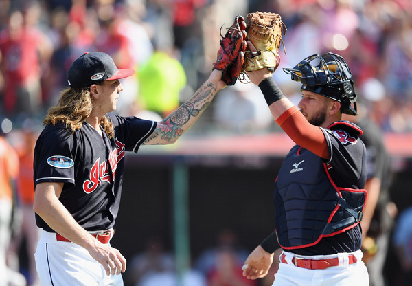 Cleveland Indians catcher Yan Gomes high fives pitcher Mike Clevinger against the Houston Astros in the 2018 MLB playoffs