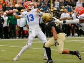 Florida Gators quarterback Feleipe Franks attempting a pass against the Vanderbilt Commodores