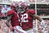 Alabama Crimson Tide wide receiver Henry Ruggs III celebrates a touchdown with Irv Smith Jr. against the Texas A&M Aggies