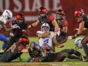 Air Force Falcons quarterback Isaiah Sanders is being tackled after running with the ball against the San Diego State Aztecs