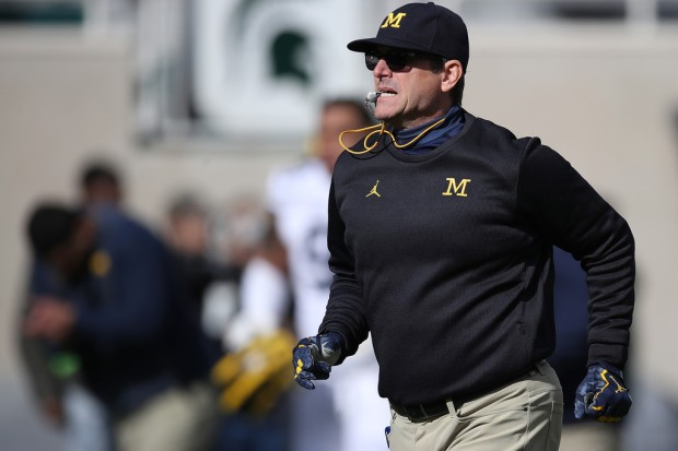 Michigan Wolverines head coach Jim Harbaugh looks on during warmups before the Michigan State Spartans game