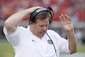 Former Florida Gators head coach Jim McElwain reacts following a play against the Georgia Bulldogs