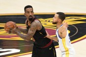 Cleveland Cavaliers swingman J.R. Smith is being guarded by Golden State Warriors guard Stephen Curry in the NBA Finals