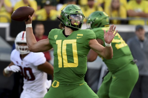 Oregon Ducks quarterback Justin Herbert throwing a pass against the Stanford Cardinal