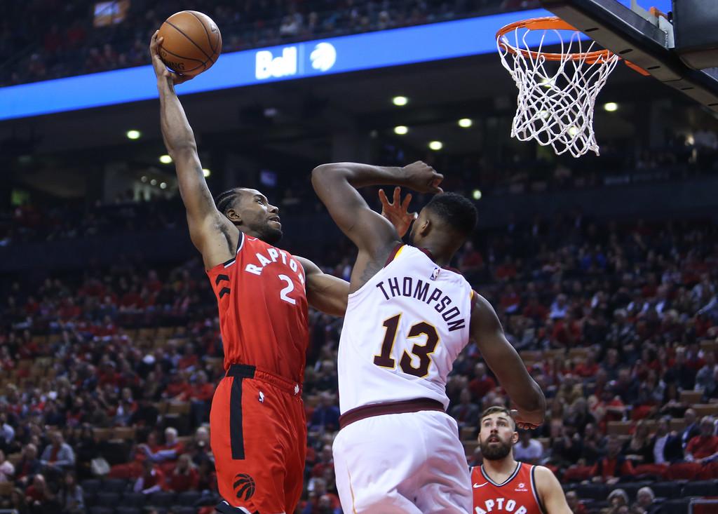 Toronto Raptors' Kawhi Leonard dunks the ball on Cleveland Cavaliers' Tristan Thompson