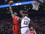 Toronto Raptors' Kawhi Leonard dunks the ball on Cleveland Cavaliers' Tristan Thompson