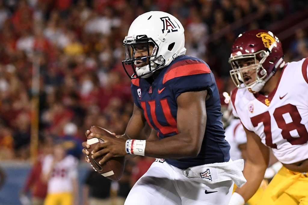 Arizona Wildcats quarterback Khalil Tate scrambles with the ball against the USC Trojans