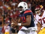 Arizona Wildcats quarterback Khalil Tate scrambles with the ball against the USC Trojans