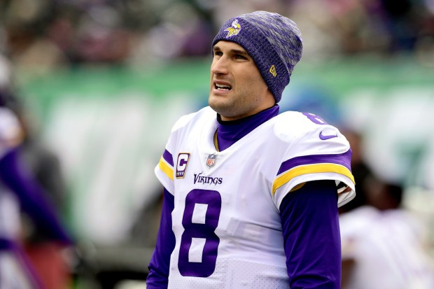 Minnesota Vikings quarterback Kirk Cousins looks on from the sidelines against the New York Jets