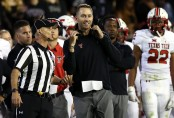 Former Texas Tech head coach Kliff Kingsbury talking to an official against the TCU Horned Frogs