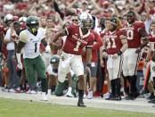 Oklahoma Sooners quarterback Kyler Murray running the ball against the Baylor Bears
