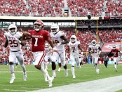 Oklahoma Sooners quarterback Kyler Murray running the ball against the Texas Longhorns