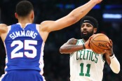 Boston Celtics guard Kyrie Irving being guarded by Philadelphia 76ers star Ben Simmons