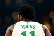 Boston Celtics guard Kyrie Irving looks on during a game against the Philadelphia 76ers